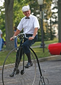 A senior citizen riding a pennyfarthing bicycle. Photo courtesy of fabulousfaces.com